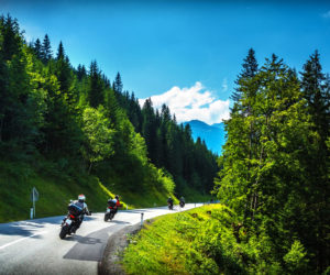Bikers in mountainous tour, travelling across Europe, curve highway in mountains, scene destinations, extreme transport, active lifestyle