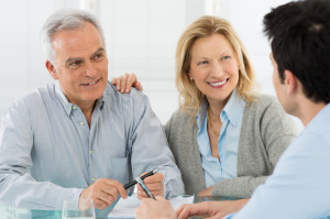 Portrait Of Happy Senior Couple Talking With A Young Man